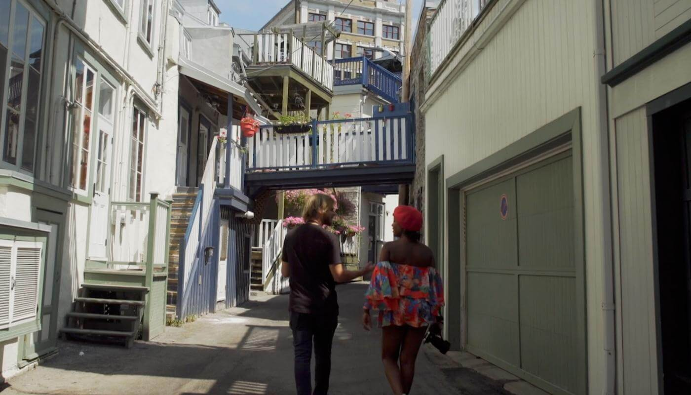 Oneika is walking with Renaud on Sous-le-Cap Street