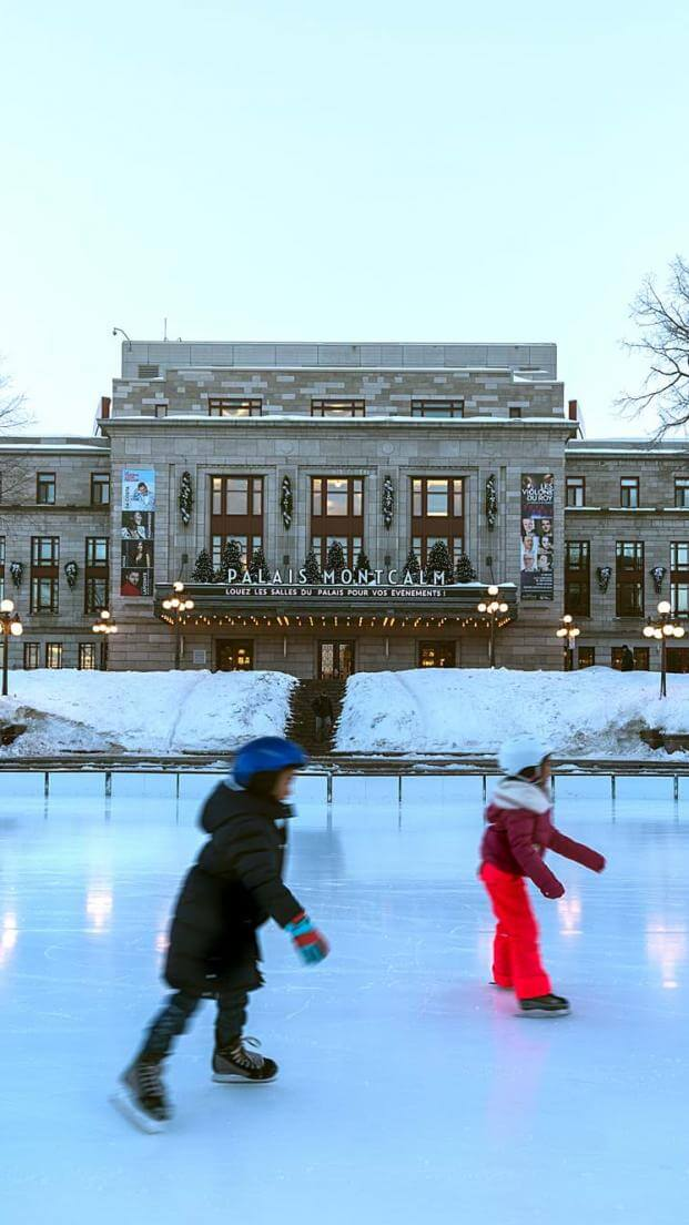 Skaters take advantage of the outdoor rink at Place D'Youville, in front of Palais Montcalm, in Old Québec.