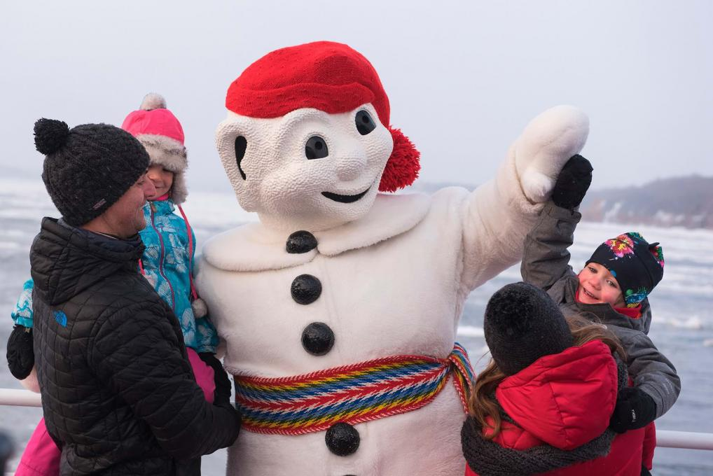 Bonhomme Carnaval meets a family in winter aboard the Québec-Lévis Ferry.