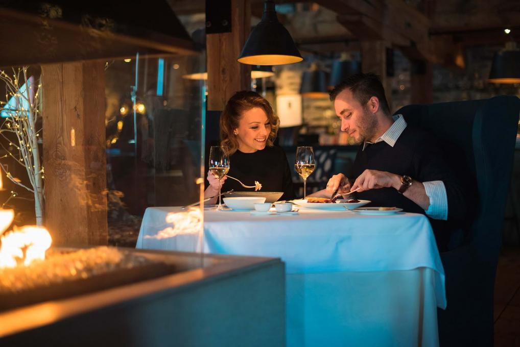 A couple enjoys the gastronomy and the romantic atmosphere at the Auberge Saint-Antoine restaurant, Chez Muffy.