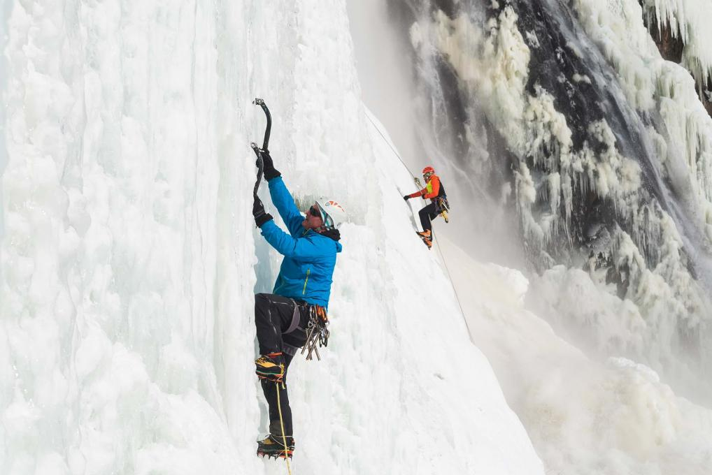 Two climbers climb an ice wall at Parc de la Chute-Montmorency, the highest waterfall in Canada.