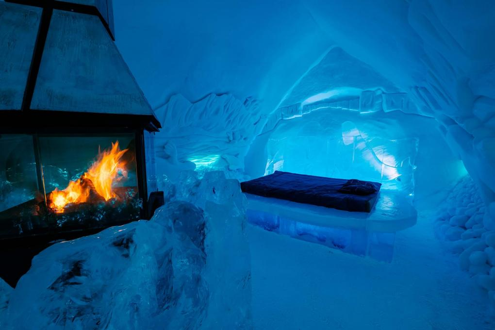 Room with a fireplace inside the Ice Hotel