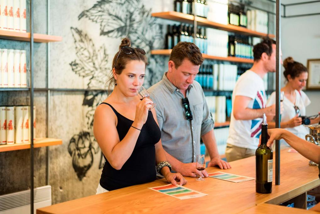 Customers participate in a wine tasting at a vineyard boutique on the Ile d'Orléans.