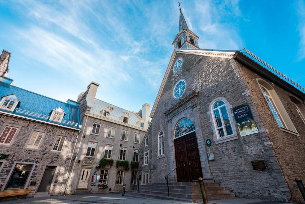 Exterior facade of Notre-Dame-des-Victoires church in the heart of Place-Royale in the Petit-Champlain district.