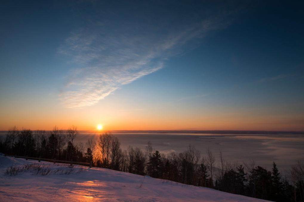 Sunset over the St. Lawrence River in winter in Charlevoix