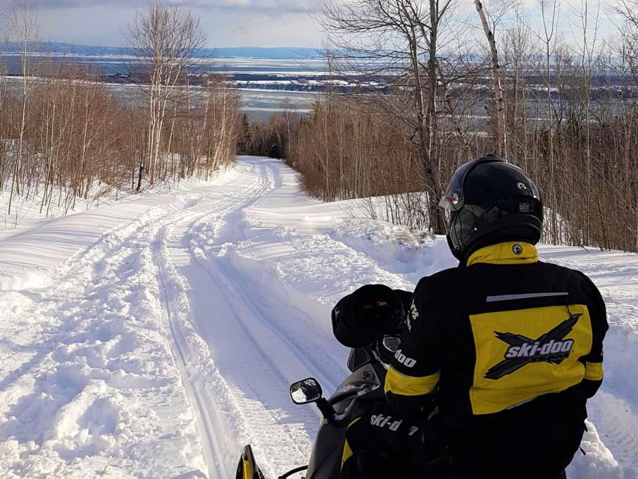 Snowmobiler riding a trail on Isle-aux-Coudres in Charlevoix