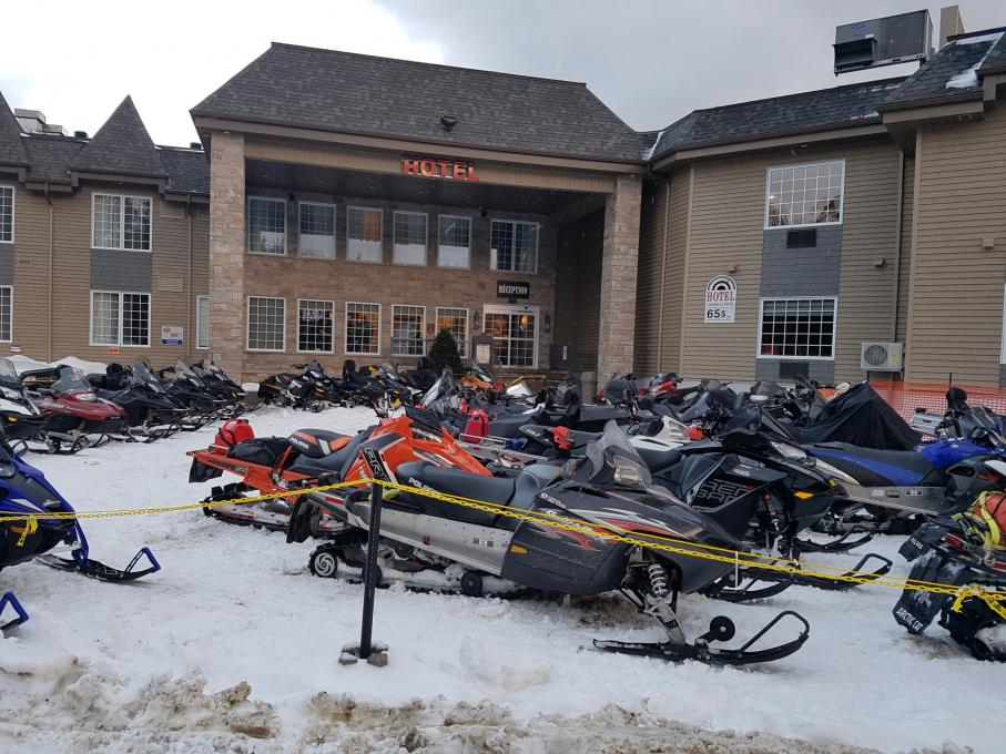 Snowmobiles parked at Hotel Petit Manoir du Casino in Charlevoix