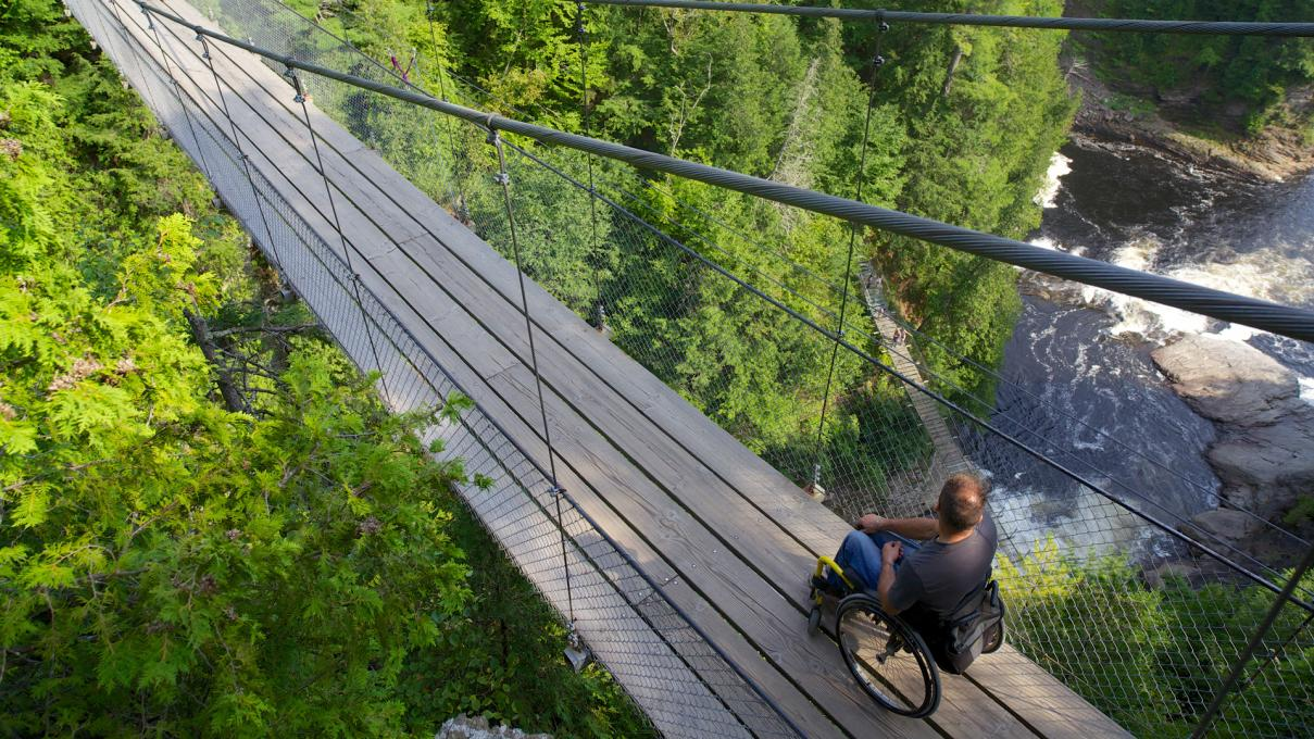 Person in wheelchair at Canyon Sainte-Anne