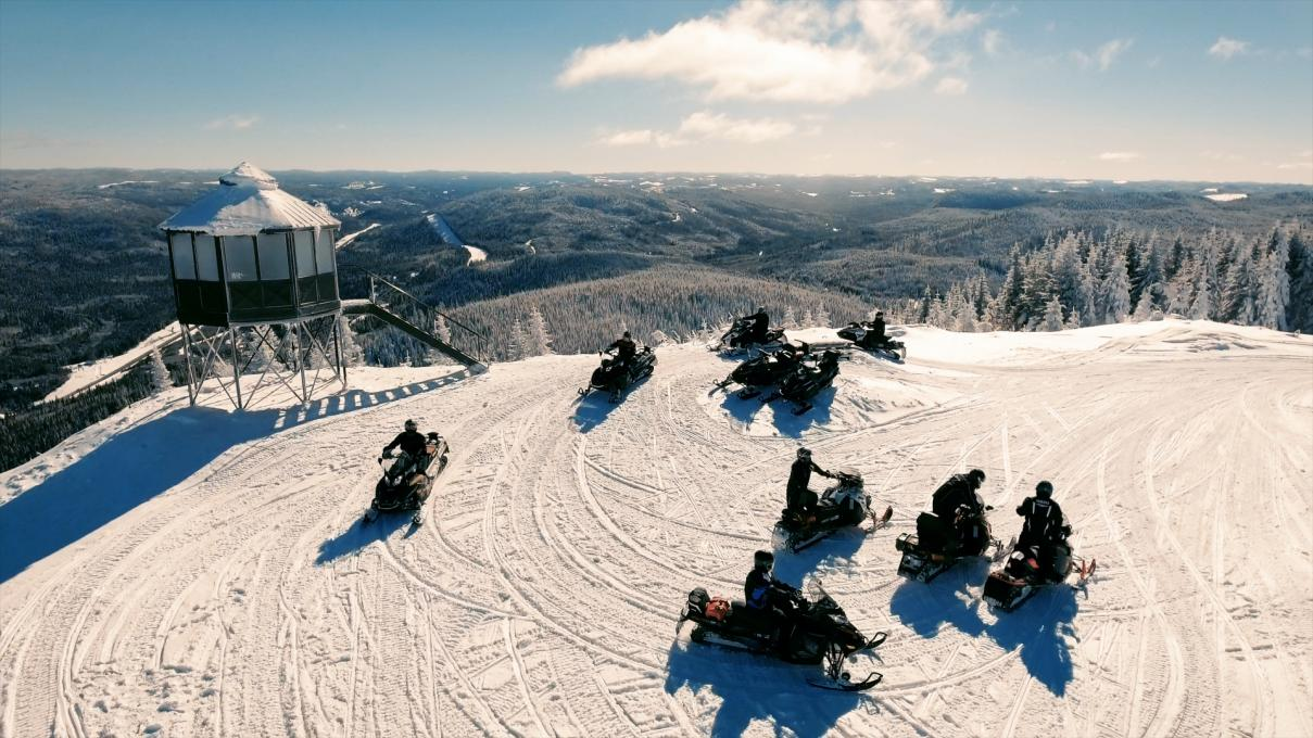 Snowmobilers at the top of Mont-Apica in Saguenay-Lac-Saint-Jean