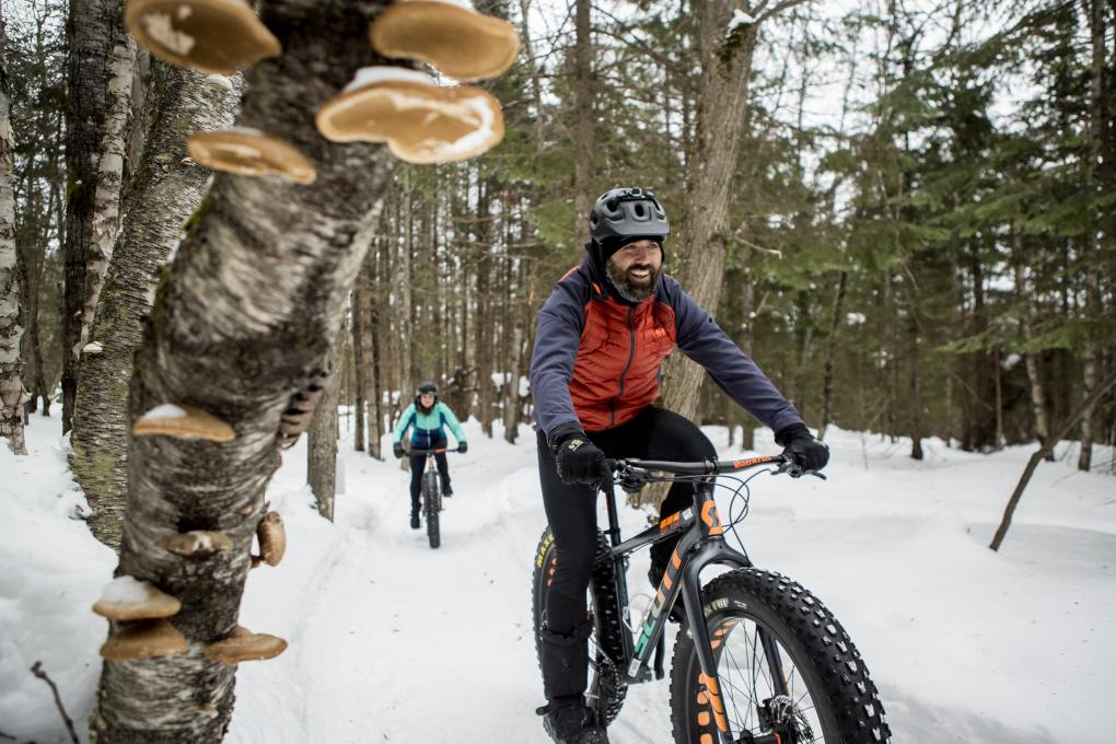 Outdoor enthusiasts ride fatbikes at Mont-Sainte-Anne.