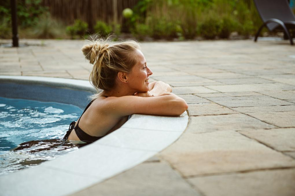 A woman relaxes in an outdoor spa at the Aroma Spa at Village Vacances Valcartier.