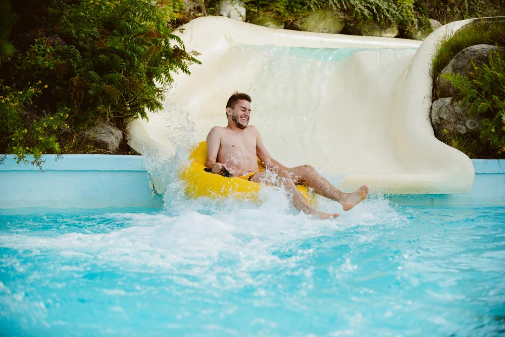 A young man in the Joyeuses Cascades slide in the outdoor water park of the Village Vacances Valcartier.