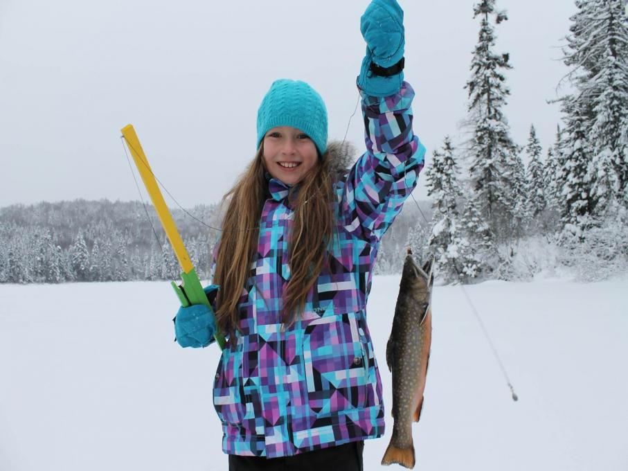 Young girl ice fishing in the Portneuf Wildlife Reserve.