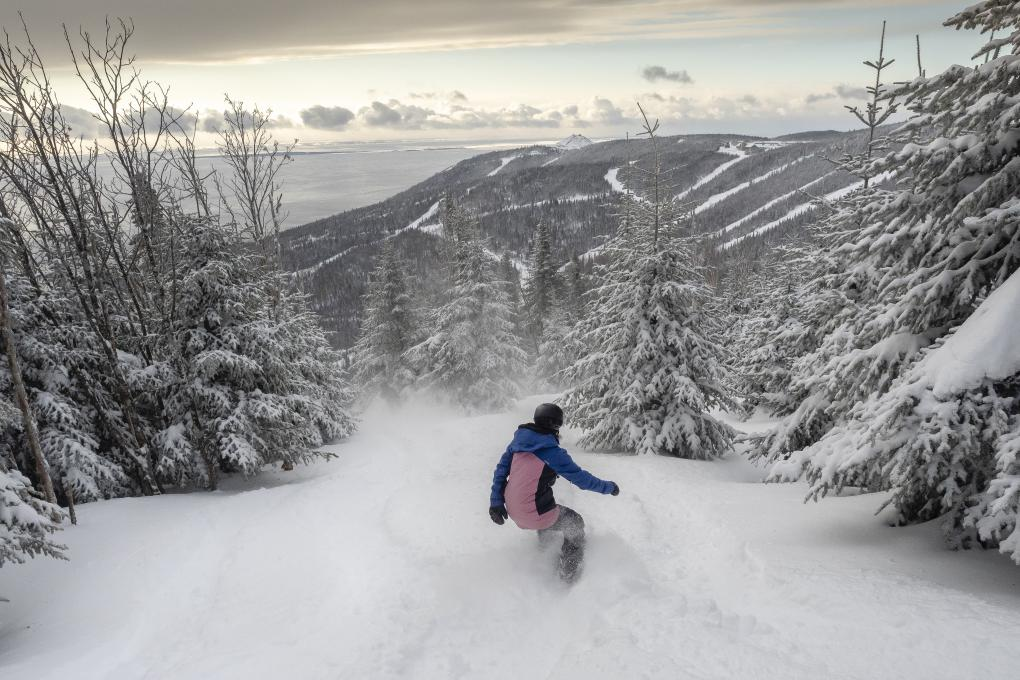 A snowboarder in the powder at Mont Liguori, in the Massif de Charlevoix.