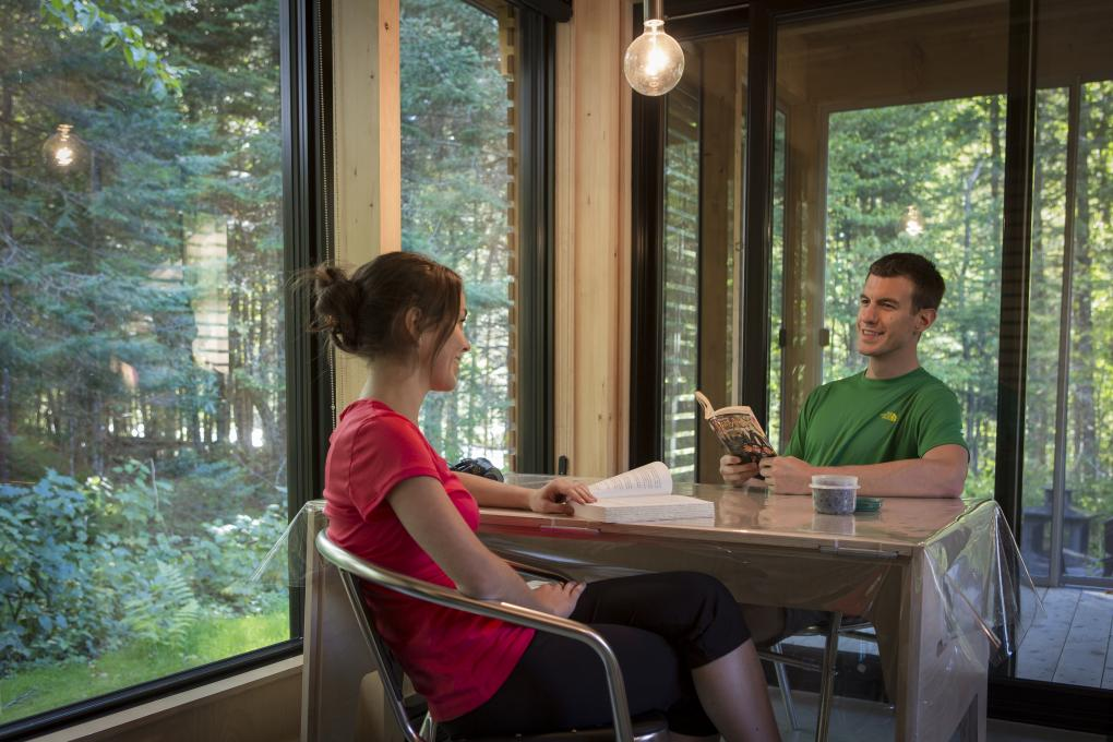 A couple inside an EXP chalet in Jacques-Cartier National Park.