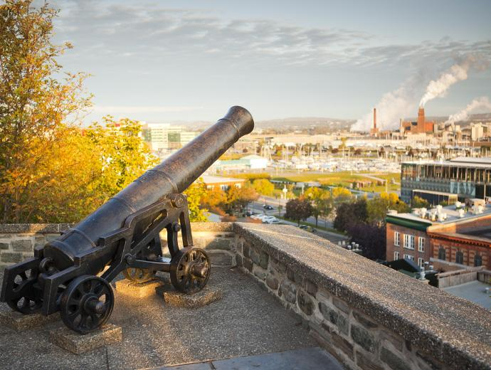 A cannon and the view of Québec City from the Fortifications-de-Québec National Historic Site.