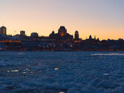 Panorama of Old Québec in winter, frozen St. Lawrence River and sunset, from the South Shore.
