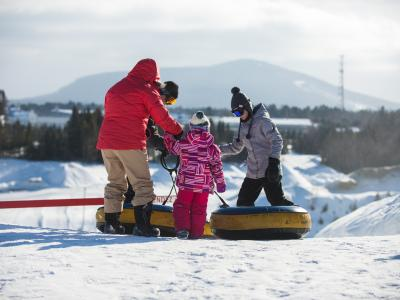 A family is getting ready to slide into the winter games center at Village Vacances Valcartier.