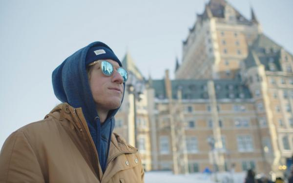 Timothy is standing in front of the Château Frontenac