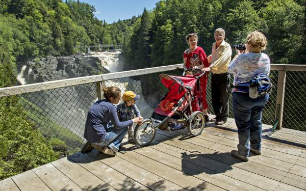 A family takes a picture of themselves on the lookout at Canyon Sainte-Anne, near Québec City.