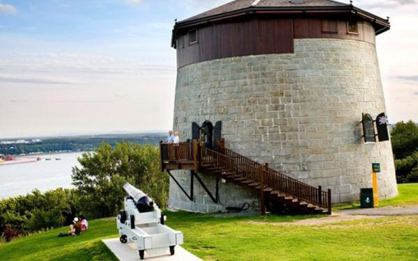 Martello Tower 1 on the Plains of Abraham and view of the St. Lawrence River in summer.