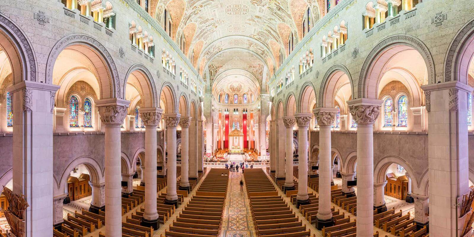 Impressive view of the interior of the Sanctuary of Sainte-Anne-de-Beaupré with its columns and detailed ceiling.
