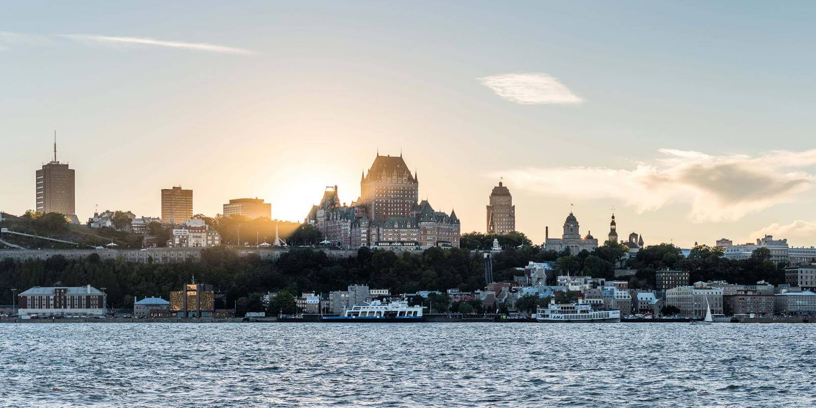 Sunset and panoramic view of Old Québec, from Lévis in summer.