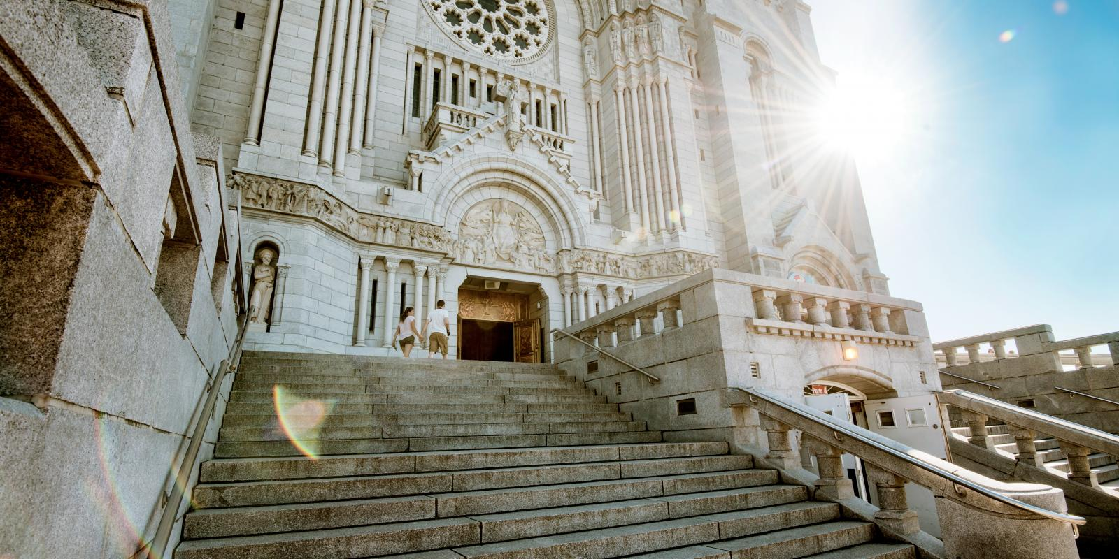 Front and exterior steps of the Sanctuary of Sainte-Anne-de-Beaupré on a sunny summer day.