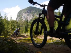 Cyclists on mountain bike trails in the Vallée Bras-du-Nord.