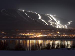 In the evening, view of the Côte-de-Beaupré, the mountain and the illuminated slopes of Mont-Sainte-Anne.