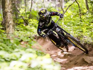 A cyclist rides a mountain bike down Mont-Sainte-Anne.