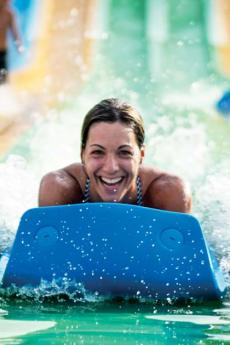 A woman slides down the Turbo 6 water slide at Village Vacances Valcartier, in summer.