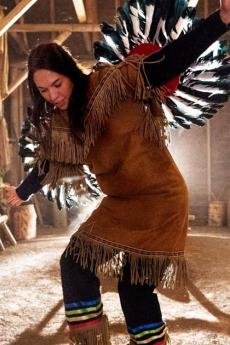 A Native American dancer performs a traditional dance inside the longhouse in Wendake.