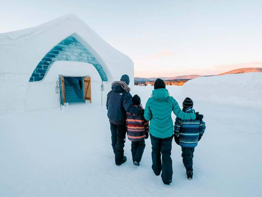 A family entering into the Ice Hotel