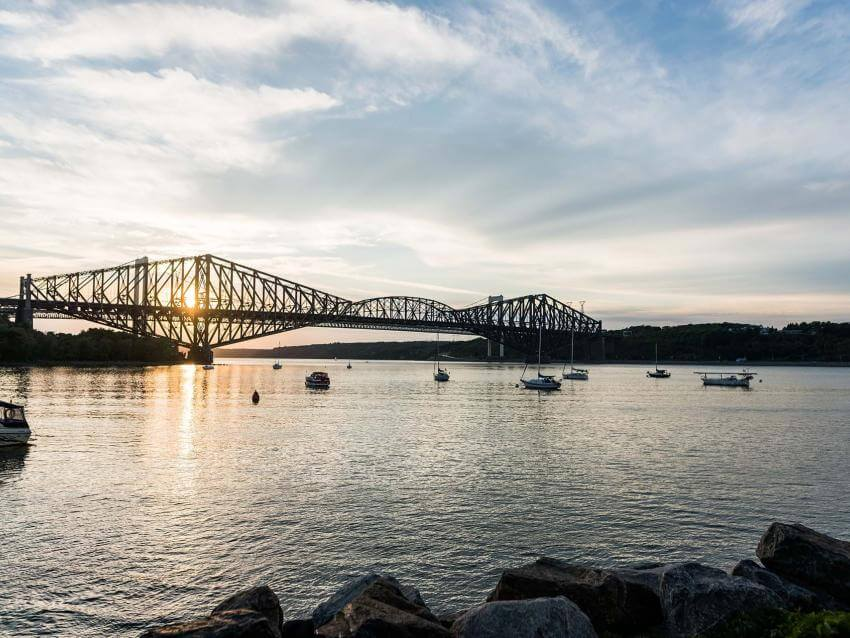 The Québec Bridge and the St. Lawrence River at sunset, from the Chaudière marina in Saint-Romuald.