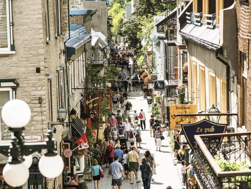 Tourists walk on rue du Petit-Champlain in summer.