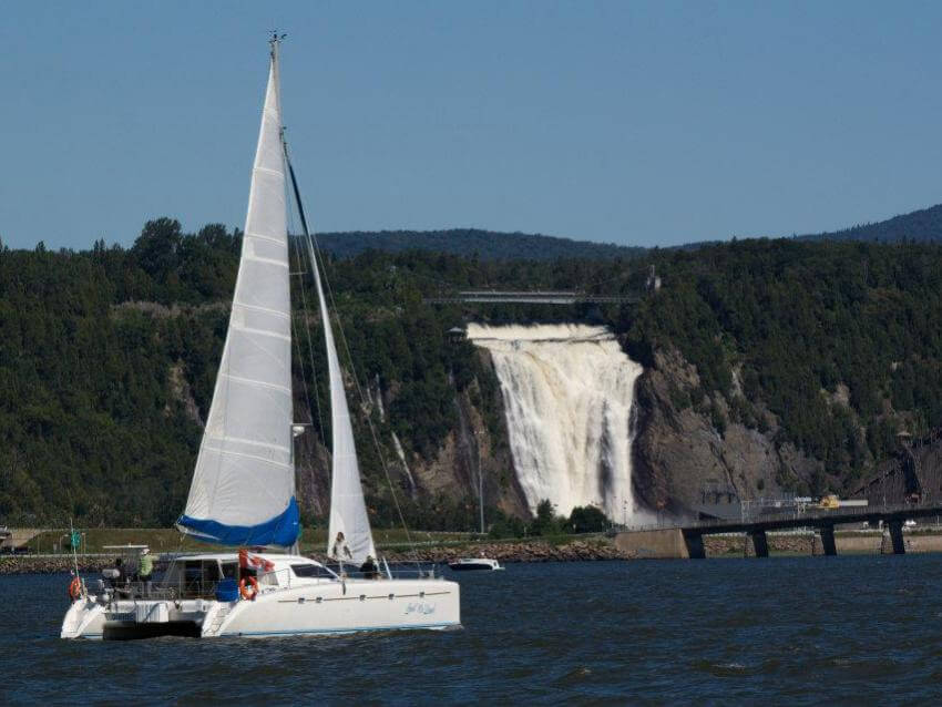 Sailboat on the river in front of Montmorency Fall