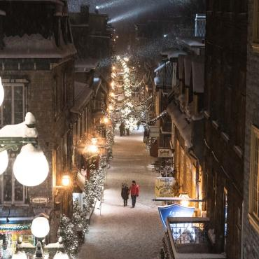 Romantic walk on rue du Petit-Champlain, illuminated and decorated in winter.