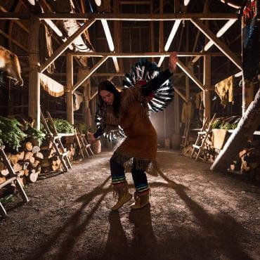 A Native American dancer performs a traditional dance inside the longhouse in Wendake, near Québec City.