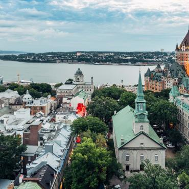 Aerial view of Old Québec, the St. Lawrence River, the Château Frontenac and the Holy Trinity Church.