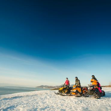 Snowmobilers overlooking the St. Lawrence River in Charlevoix