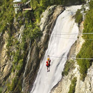 The zip line at Parc de la Chute-Montmorency with the waterfall in the background.